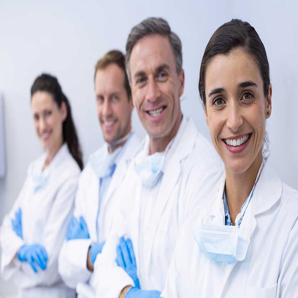this is a group of smiling dentists